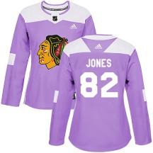 Caleb Jones Chicago Blackhawks Adidas Women's Authentic Fights Cancer Practice Jersey - Purple
